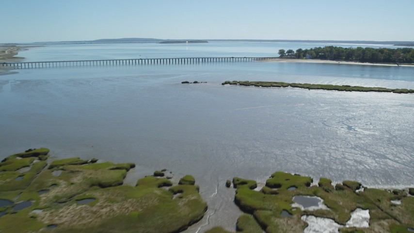 6K stock footage aerial video flying over marshland, approach Powder Point Bridge, Duxbury, Massachusetts Aerial Stock Footage | AX143_066