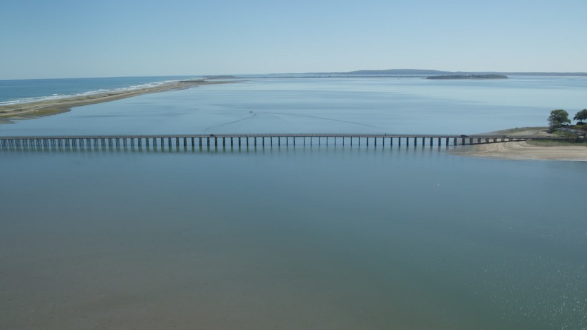6K stock footage aerial video flying by Powder Point Bridge, Duxbury, Massachusetts Aerial Stock Footage | AX143_067