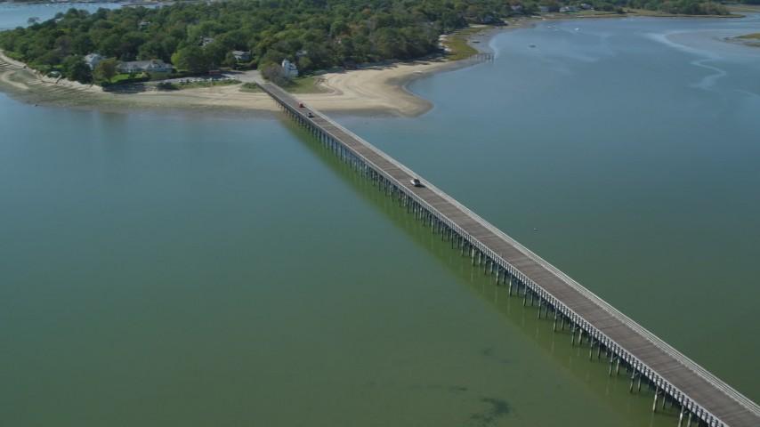 6K stock footage aerial video orbiting Powder Point Bridge, light traffic, Duxbury, Massachusetts Aerial Stock Footage | AX143_069