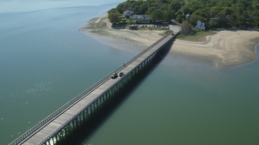 6K stock footage aerial video orbiting Powder Point Bridge, light traffic, Duxbury, Massachusetts Aerial Stock Footage | AX143_070
