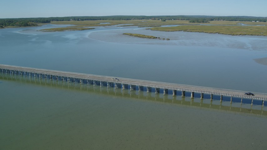 6K stock footage aerial video flying by the Powder Point Bridge, light traffic, Duxbury, Massachusetts Aerial Stock Footage | AX143_074