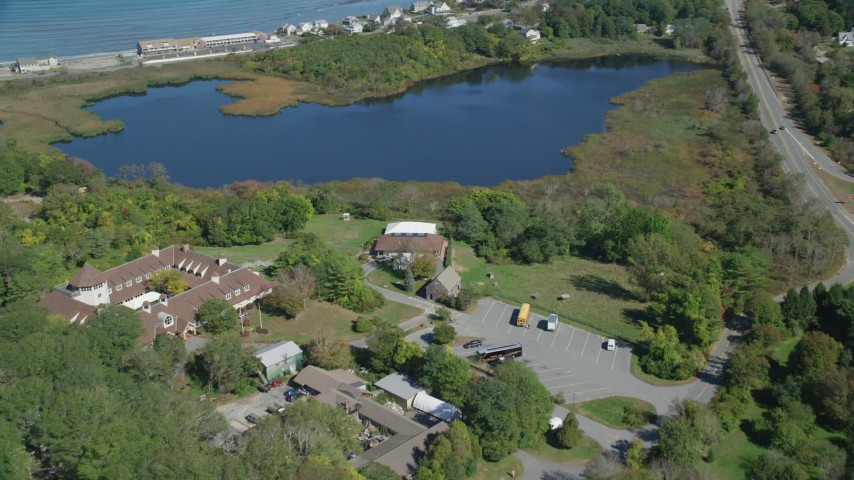 6K stock footage aerial video approaching Plimoth Plantation visitors center, Plymouth, Massachusetts Aerial Stock Footage | AX143_105