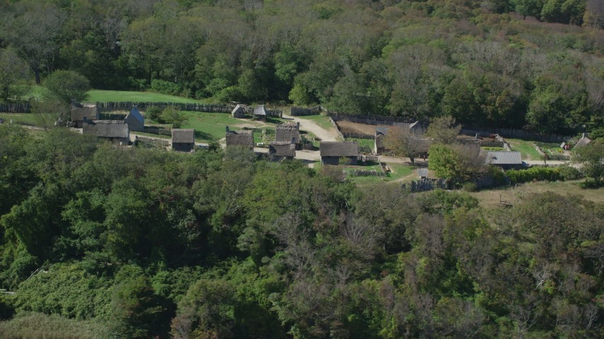 6K stock footage aerial video orbiting Plimoth Plantation, green trees, Plymouth, Massachusetts Aerial Stock Footage | AX143_106