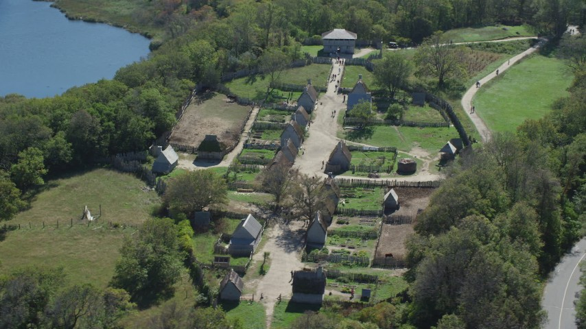 6K stock footage aerial video orbiting Plimoth Plantation, revealing body of water,  Plymouth, Massachusetts Aerial Stock Footage | AX143_108