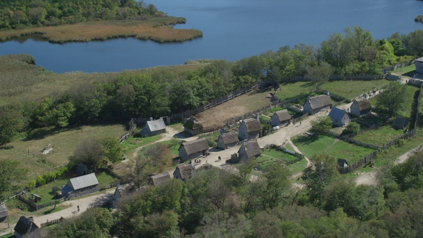 6K stock footage aerial video orbiting Plimoth Plantation, near water, Massachusetts Aerial Stock Footage | AX143_109