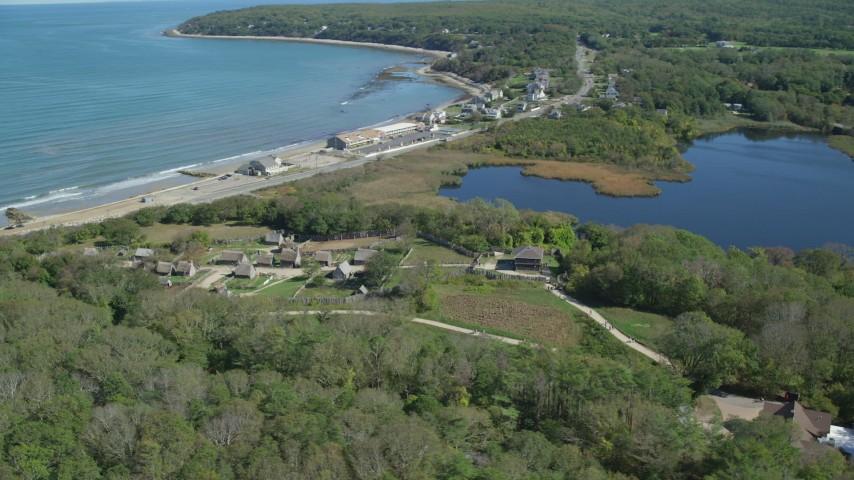 6K stock footage aerial video orbiting Plimoth Plantation, coastal community, Plymouth, Massachusetts Aerial Stock Footage | AX143_110