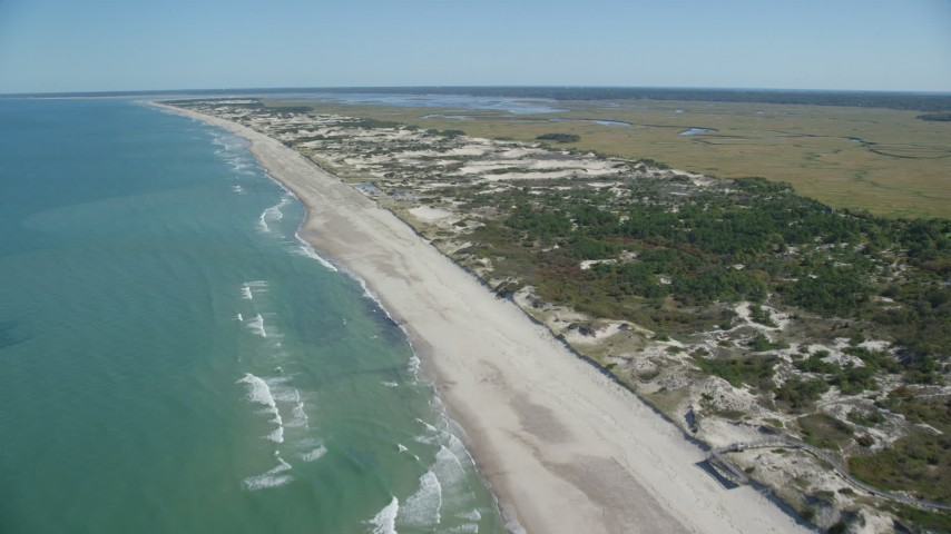 6K aerial video approaching and flying over a beach, Barnstable, Massachusetts Aerial Stock Footage | AX143_131