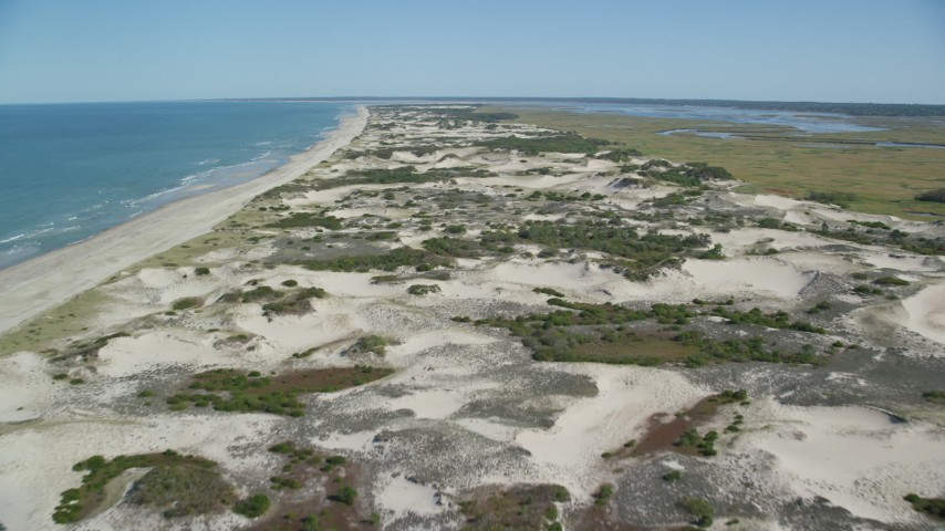 Flying over sand dunes near the beach, Barnstable, Cape Cod, Massachusetts Aerial Stock Footage   AX143_133