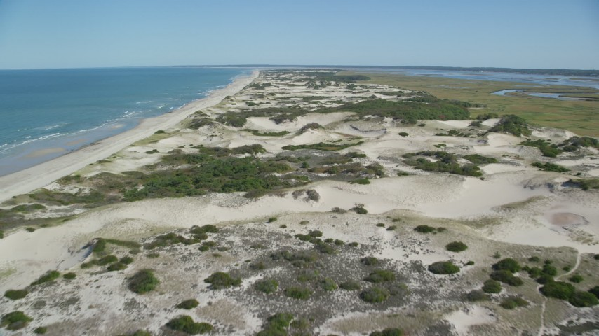 6K aerial video flying over sand dunes near the beach, Barnstable, Cape Cod, Massachusetts Aerial Stock Footage | AX143_133