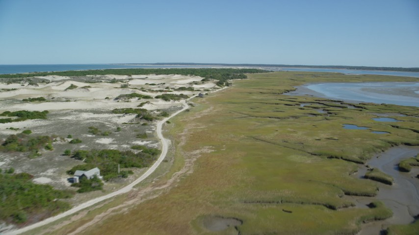 Isolated home, coastal road, marshland, sand dunes, Barnstable, Massachusetts Aerial Stock Footage | AX143_139