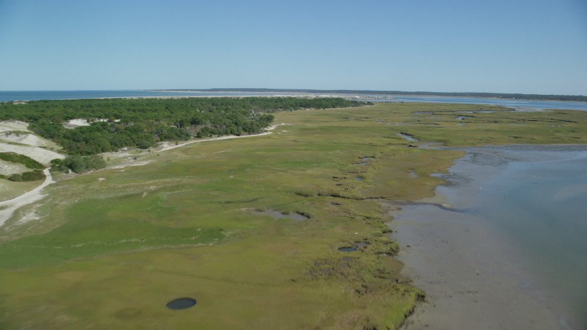 Marshland, coastal road, isolated homes, Cape Cod, Barnstable, Massachusetts Aerial Stock Footage | AX143_140