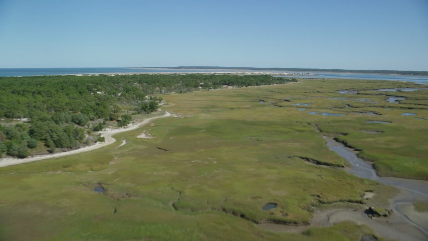 6K stock footage aerial video of Marshland, coastal road, isolated homes, Cape Cod, Barnstable, Massachusetts Aerial Stock Footage | AX143_140