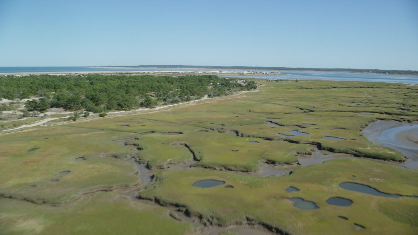 Marshland, coastal road, isolated home, Cape Cod, Barnstable, Massachusetts Aerial Stock Footage | AX143_141