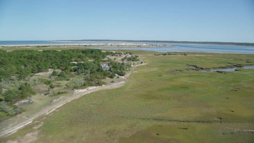 6K aerial video of Marshland, coastal road, isolated home, Cape Cod, Barnstable, Massachusetts Aerial Stock Footage | AX143_141