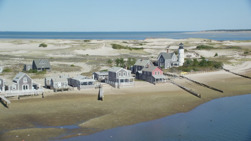 Sandy Neck Colony, Sandy Neck Light, Cape Cod, Barnstable, Massachusetts Aerial Stock Footage AX143_144