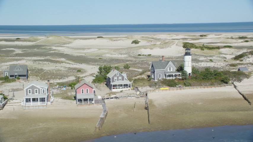 6K stock footage aerial video of Sandy Neck Colony, Sandy Neck Light, Cape Cod, Barnstable, Massachusetts Aerial Stock Footage AX143_144 | Axiom Images