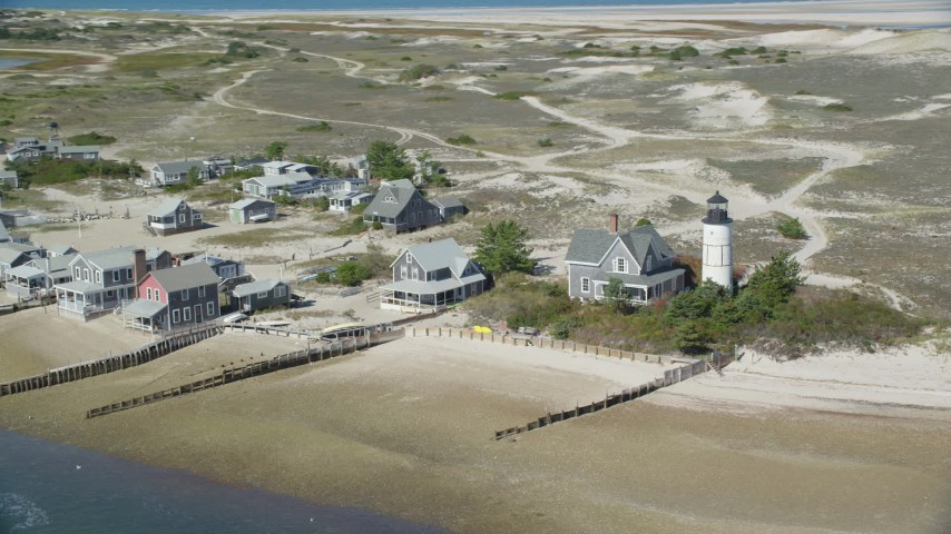 Sandy Neck Colony, Sandy Neck Light, Cape Cod, Barnstable, Massachusetts Aerial Stock Footage AX143_145