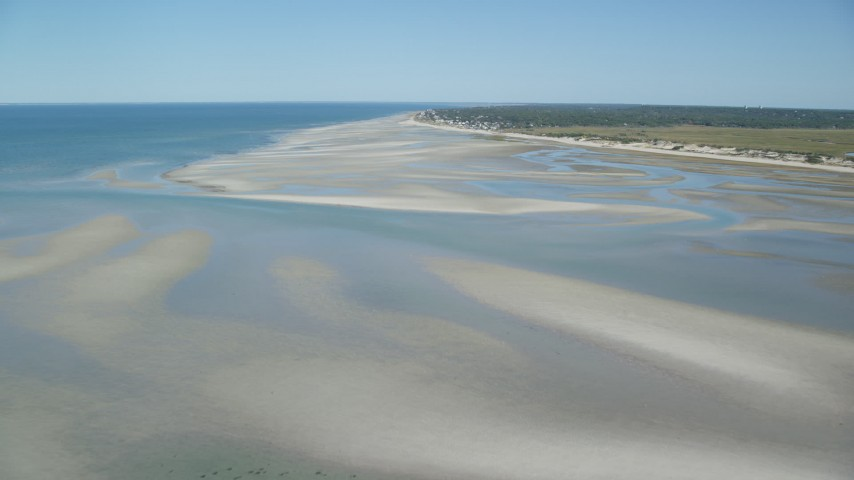 Fly over sand bars, approach small coastal town, Cape Cod, Dennis, Massachusetts Aerial Stock Footage | AX143_149