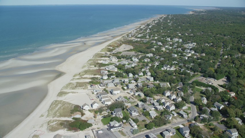 Fly over small coastal town, by sand bars, Cape Cod, Dennis, Massachusetts Aerial Stock Footage | AX143_152