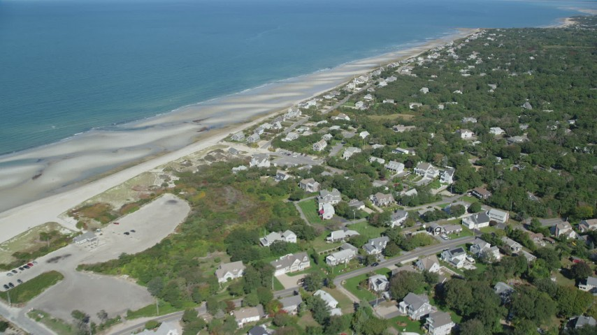 6K aerial video flying over small coastal town, by sand bars, Cape Cod, Dennis, Massachusetts Aerial Stock Footage | AX143_152