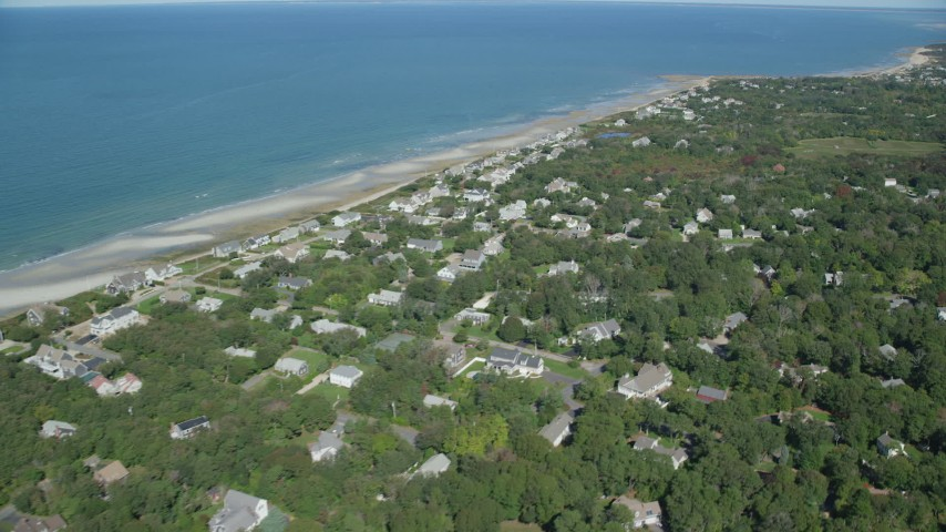 Fly by sand bars, small coastal town, Cape Cod, Dennis, Massachusetts Aerial Stock Footage | AX143_153