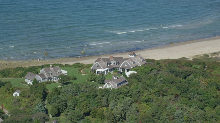 Flying by upscale beachfront homes, Cape Cod, Dennis, Massachusetts Aerial Stock Footage | AX143_157