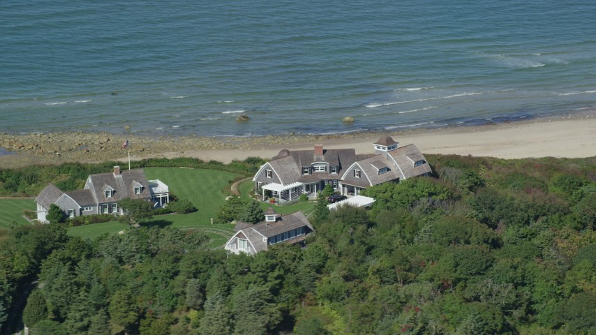 6K stock footage aerial video flying by upscale beachfront homes, Cape Cod, Dennis, Massachusetts Aerial Stock Footage | AX143_157