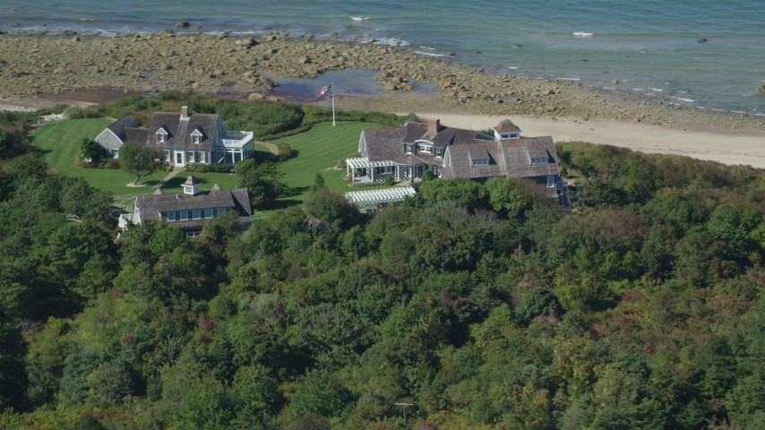 Flying by upscale beachfront homes, Cape Cod, Dennis, Massachusetts Aerial Stock Footage | AX143_158