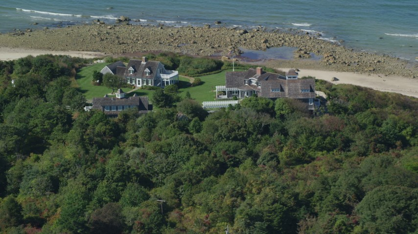 6K stock footage aerial video flying by upscale beachfront homes, Cape Cod, Dennis, Massachusetts Aerial Stock Footage | AX143_158