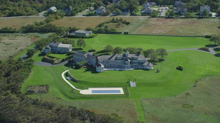 6K aerial video orbiting a mansion, Cape Cod, Dennis, Massachusetts Aerial Stock Footage | AX143_159