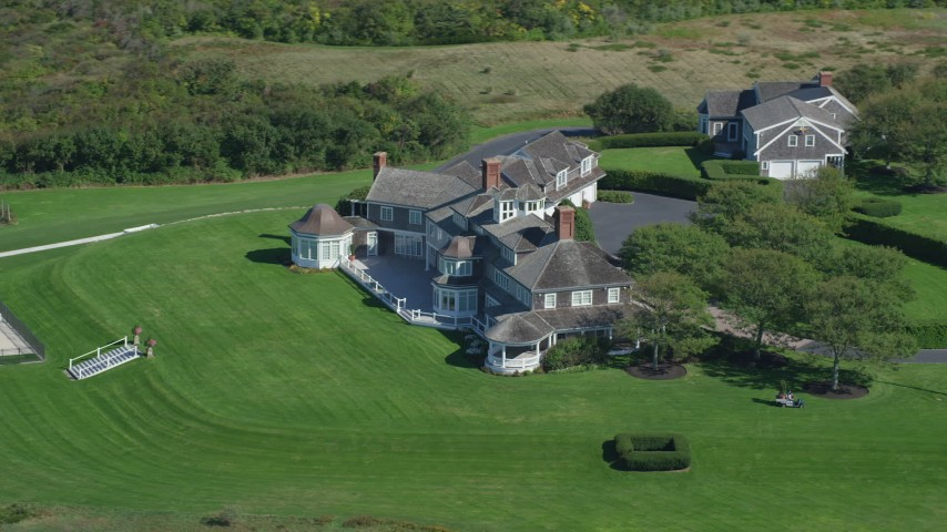 Orbiting mansion, green lawns, Cape Cod, Dennis, Massachusetts Aerial Stock Footage | AX143_161