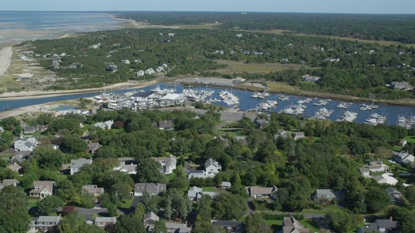 Approaching Jesuit Harbor, marina, Cape Cod, Dennis, Massachusetts Aerial Stock Footage | AX143_163