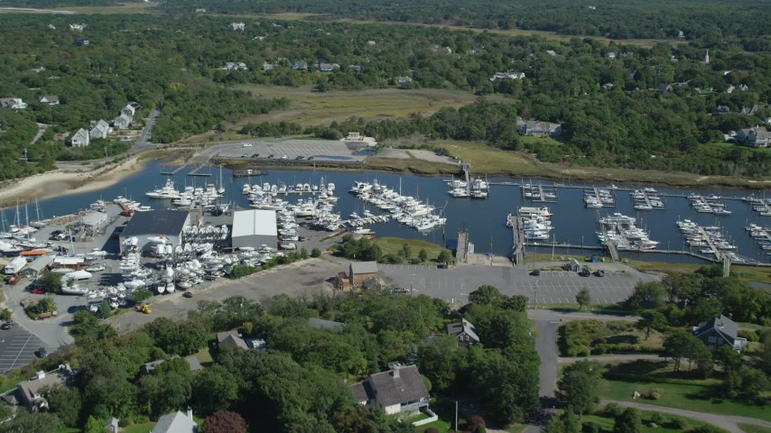 6K stock footage aerial video approaching Jesuit Harbor, marina, Cape Cod, Dennis, Massachusetts Aerial Stock Footage | AX143_163