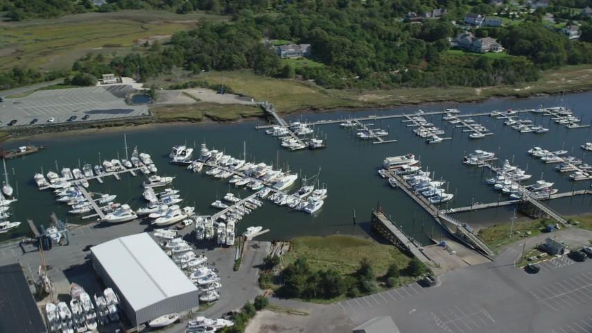 Flying by Sesiut Harbor, marina, Cape Cod, Dennis, Massachusetts Aerial Stock Footage | AX143_164