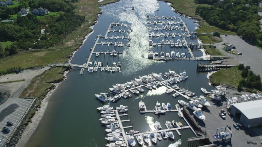 Flying by Sesiut Harbor, marina, Cape Cod, Dennis, Massachusetts Aerial Stock Footage | AX143_164