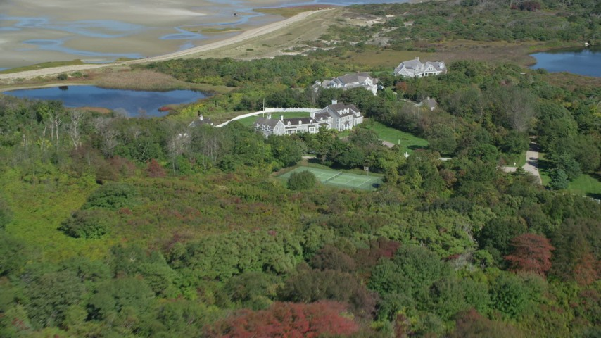 Flying by mansion, tennis court, swimming pool, Dennis, Massachusetts Aerial Stock Footage | AX143_165