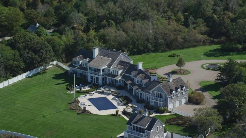 Orbiting mansion, swimming pool, Cape Cod, Dennis, Massachusetts Aerial Stock Footage | AX143_168