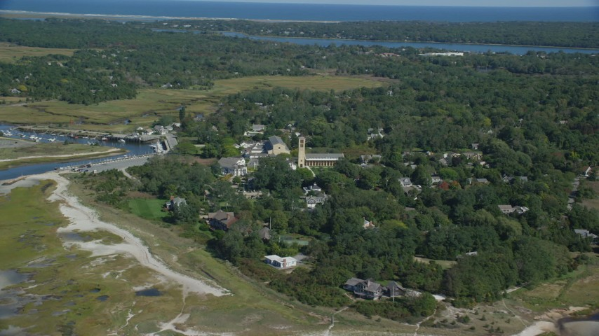 6K stock footage aerial video flying by small coastal town, Church of the Transfiguration, Orleans, Massachusetts Aerial Stock Footage | AX143_179