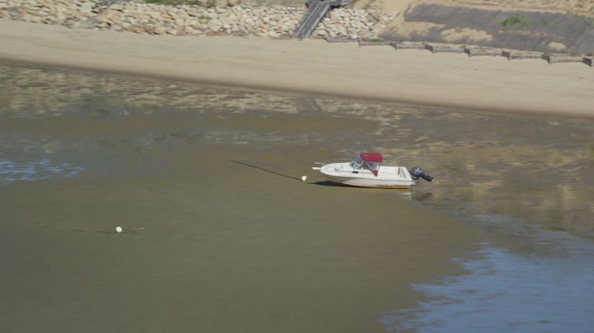 Flying by beached fishing boat on sandbar, Cape Cod, Eastham, Massachusetts Aerial Stock Footage   AX143_187