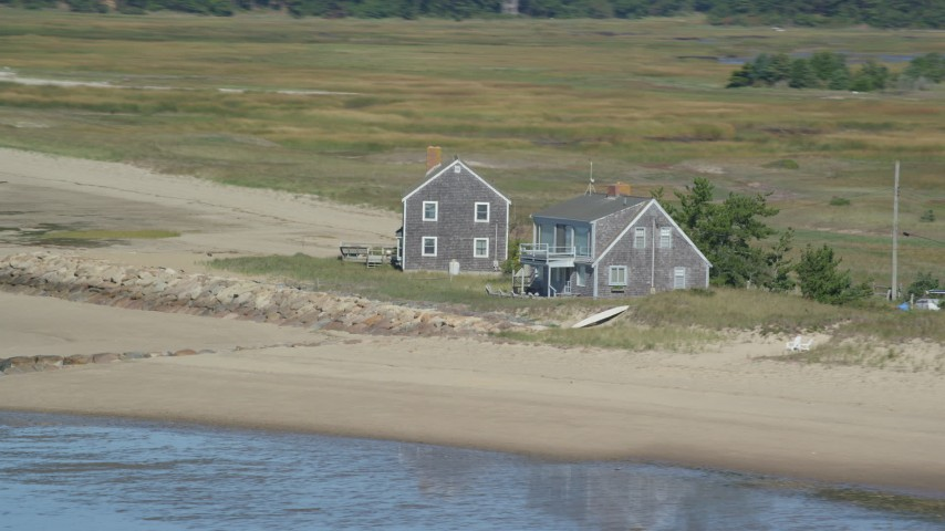 6K aerial video flying by isolated beachfront homes, Cape Cod, Eastham, Massachusetts Aerial Stock Footage | AX143_189