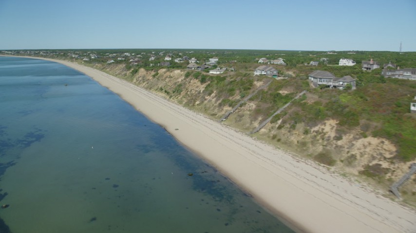 6K stock footage aerial video flying by beach, homes with ocean views, Cape Cod, Truro, Massachusetts Aerial Stock Footage | AX143_209