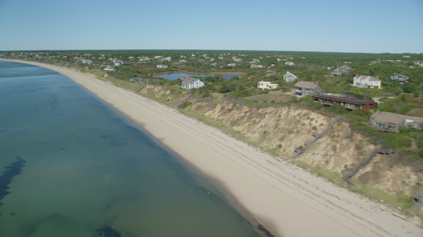 6K stock footage aerial video flying by beach, homes with ocean views, Cape Cod, Truro, Massachusetts Aerial Stock Footage | AX143_210
