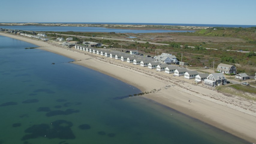 6K aerial video flying by Top Mast Resort, Days' Cottages, Cape Cod, Truro, Massachusetts Aerial Stock Footage AX143_214