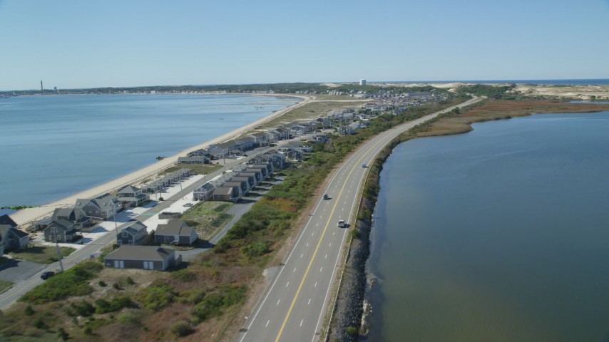 6K aerial video flying over beachfront homes, Highway 6, coastal road, Truro, Massachusetts Aerial Stock Footage | AX143_216