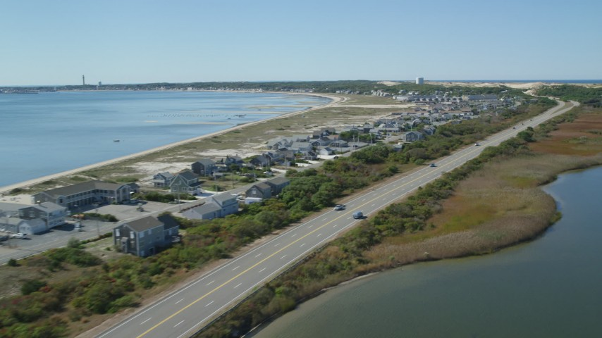 6K stock footage aerial video flying by beachfront homes, Highway 6, coastal road, Truro, Massachusetts Aerial Stock Footage | AX143_217