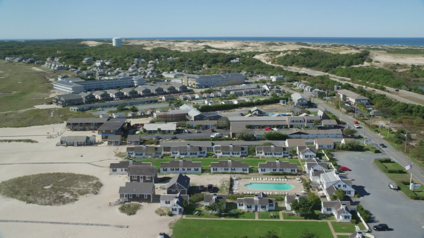 6K aerial video flying by Kalmar Village, Sandcastle Resort, Truro, Massachusetts Aerial Stock Footage | AX143_219