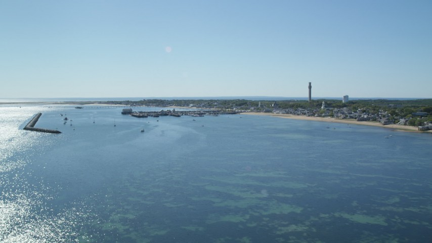 6K stock footage aerial video approaching piers, small coastal town, Provincetown, Massachusetts Aerial Stock Footage | AX143_221