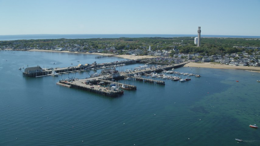 6K stock footage aerial video flying by piers, small coastal town, Provincetown, Massachusetts Aerial Stock Footage | AX143_222