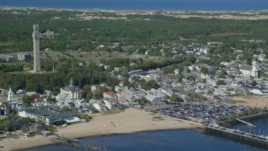 6K stock footage aerial video orbiting Pilgrim Monument, Provincetown City Hall, Provincetown, Massachusetts Aerial Stock Footage | AX143_235