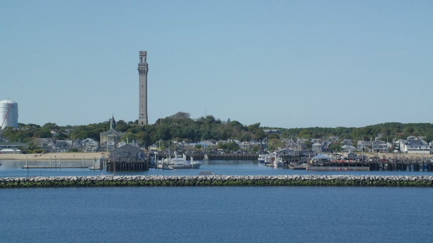 6K stock footage aerial video approaching small coastal town, Pilgrim Monument, Provincetown, Massachusetts Aerial Stock Footage   AX143_246